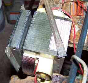 Cutting open microwave oven 		transformer